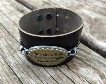 Proverbs 31 Leather Cuff. She is clothed in strength and dignity.