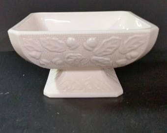 Vintage pink milk glass square  bowl. Pedestal