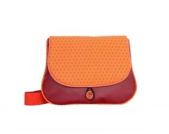 Flat faux Burgundy leather and fabric bag orange print