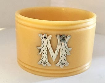 bakelite early 20th century with silver letter M
