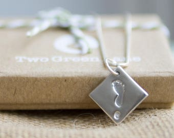 Fine Silver footprint necklace featuring the unique print of your loved one