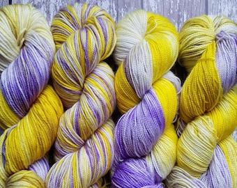 Pansy Face violet and yellow superwash merino yarn.