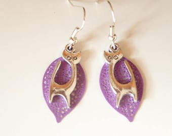 earring with silver cat and Parma violet leaf