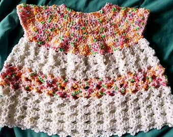Handcrafted pink and white baby dress