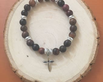 Womens' beaded bracelet with cross charm