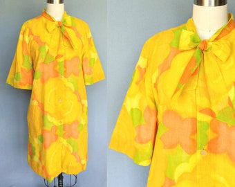 cantaloupe / 1960s yellow and orange floral house dress / tent dress /