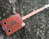 Acoustic Arturo Fuente Cigar Box Guitar. Convertible (opens up to put stash, picks slides etc!)  Great gift for a guitarist!