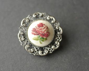 Petit point rose cross stitch brooch with ornate silver tone filigree surround