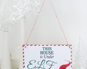 This house is under elf surveillance wooden hanging plaque