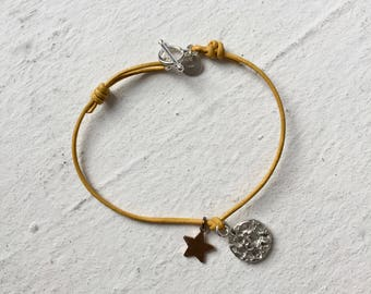 Yellow leather bracelet with charms
