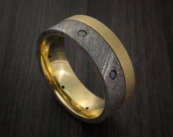 Gibeon meteorite and yellow gold band with black diamonds