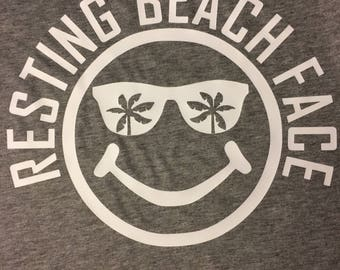 Resting Beach Face Grey Unisex TShirt smiling sunglasses palm trees