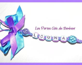 key 1 bis line purple/turquoise color with a bow
