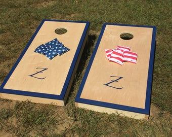 Set of custom regulation size cornhole / beanbag toss boards with bags