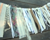 Garland of laces, fabrics, ribbons. Shabby chic, romantic, vintage.
