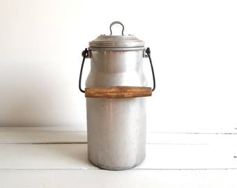 Country style rustic old milk can