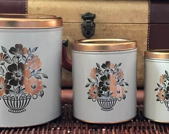 Three Decoware Tin Canisters