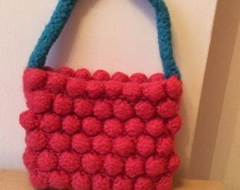 Hand knitted and felted handbag