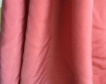Fabric polyester 140 width between the coral orange color