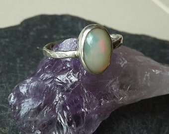 Silver ring with oval ethiopian Opal and hammered ring band