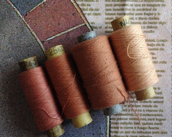 Spools of cotton threads in set. 4 spools in set: beige, natural colors.