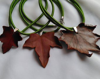Hanging leaf dry hand made in leather. Botanical jewelry leather