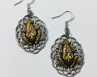 Brass Frog Pressing on Filigree Oval Earrings by Ten Dollar Studio where all items are always Ten dollars