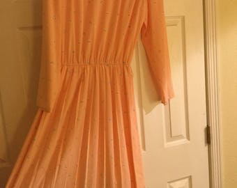 Size 8 peach dress with pletes