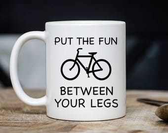 Funny Cyclist Mug - Put The Fun Between Your Legs Coffee & Tea Mug - Best Hilarious Cycling Teacup Gift - 11oz Ceramic Bike Rider/Lover Cup