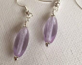 Purple dangle earrings. Purple drop earrings. Purple boho earrings.  Lavender earrings. Purple earrings. On silver ear wires.