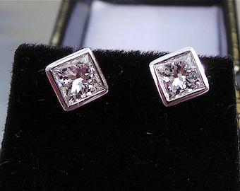 Princess cut diamond earrings in 18 carat white gold