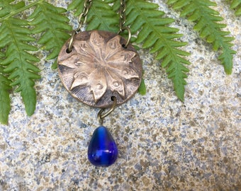 Large 9 Pointed Star Circle Pendant with Blue Glass Drop