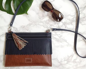Cognac brown leather crossbody bag with tassel and dark blue moustache