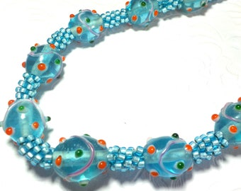 Large blue glass  beaded necklace woven on a Kumihimo braid
