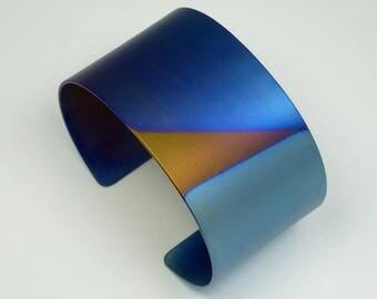 Anodized titanium cuff bracelet.