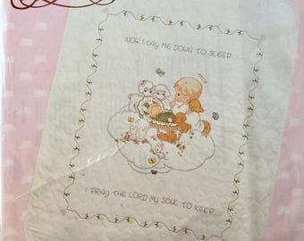 """Baby's Arrival Quilt, Precious Moments, stamped cross stitch, 34"""" by 43"""" , designed by Gloria and Pat,  """"Now I lay me down to Sleep"""""""