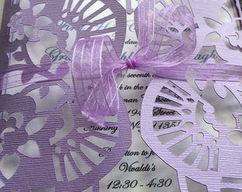 Fold over cut out invitation with ribbon closure