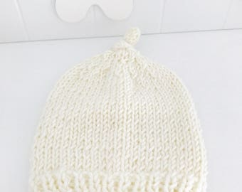 Newborn Beanie White. White knotted cap made of merino wool knit. Handmade newborn gift.