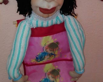Handmade doll with 4 pockets for storing items.