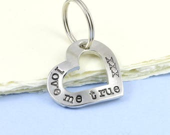 Cut Out Heart Keyring in Pewter with the message Love me True xxx hand stamped around it makes a gift of love