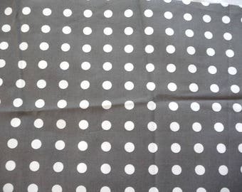 Beige cotton fabric with white polka dots