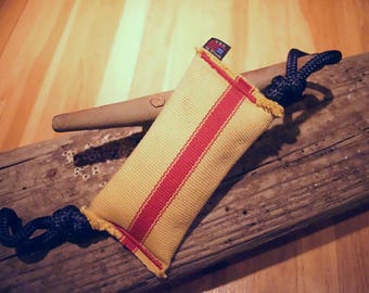 Durable handcrafted repurposed firehose dog toy