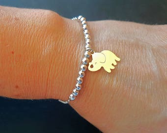 Bracelet with rhodium-plated silver beads and elephant-shaped charm pendant in sterling silver gold.