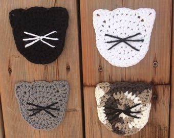 Crocheted cat face coasters