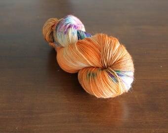 Handdyed yarn, sock yarn, fingering weight, yarn, socksanity, socksanity Chiron, orange, black, purple