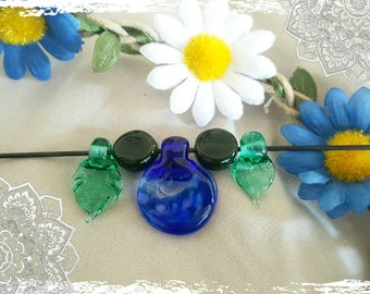 Set of lampwork beads. Blue pendant with green transparent leafs.