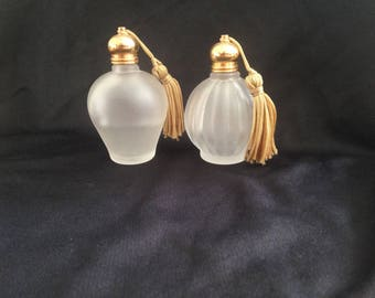 Beautiful old perfume bottles with brush caps