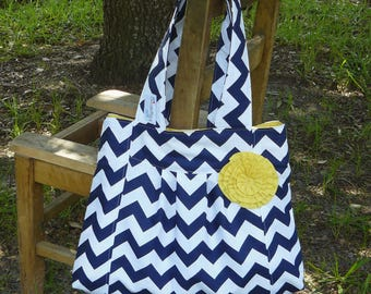 Navy blue chevron pleated purse with yellow lining and rosette, The Carenters Wife