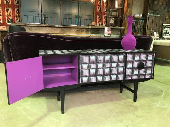"""A """"Trippy"""" up-cycled vintage sideboard reimagined with 90s 'acid-house' paper"""