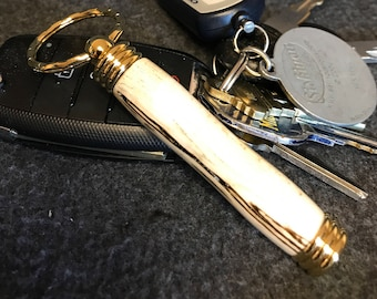 Spalted beechnut wood hand turned secret compartment keychain with 24k gold plated accents